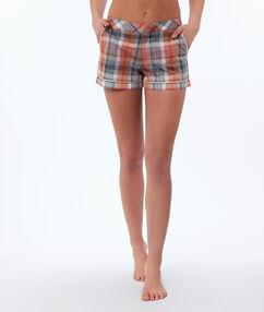 Short à carreaux orange.