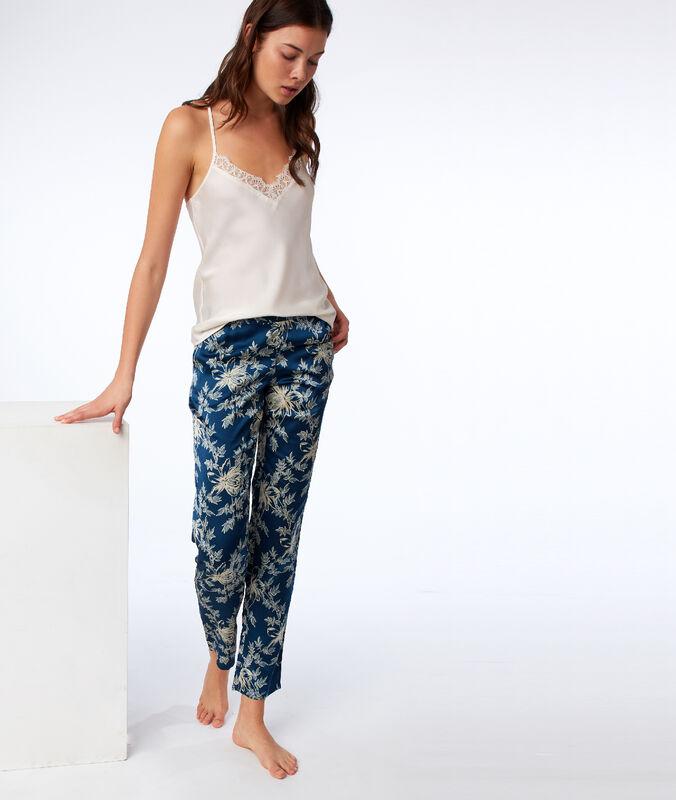 Pantalon satin motif fleuri bleu.