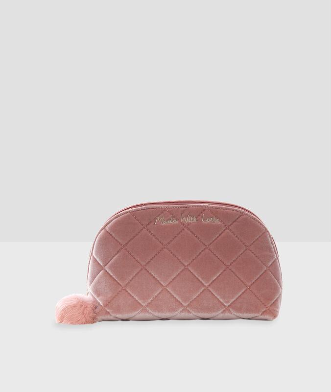 Trousse de toilette avec pompon rose.