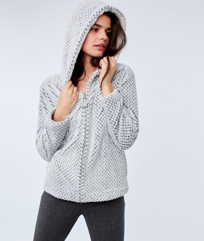Veste à capuche en fausse fourrure gris.